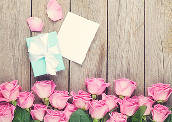 pink roses with gift and card