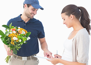 woman receiving a bouquet of flowers
